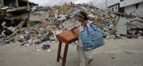 A woman carries a table through the street after an earthquake in Pedernales, Ecuador, Sunday, April 17, 2016. Rescuers pulled survivors from the rubble Sunday after the strongest earthquake to hit Ecuador in decades flattened buildings and buckled highways along its Pacific coast on Saturday. The magnitude-7.8 quake killed hundreds of people. (AP Photo/Dolores Ochoa)
